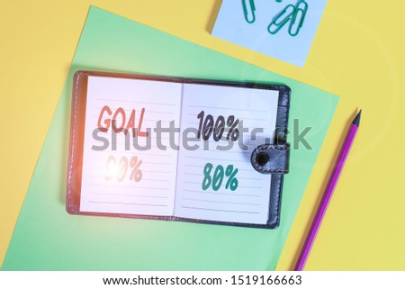 Conceptual hand writing showing Goal 100 Percent 90 Percent 80 Percent. Business photo showcasing Percentage of your objectives fulfilment success level Locked diary striped sheets clips notepad