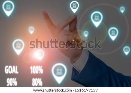 Conceptual hand writing showing Goal 100 Percent 90 Percent 80 Percent. Business photo text Percentage of your objectives fulfilment success level Male wear formal work suit presenting presentation