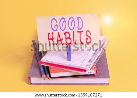 Conceptual hand writing showing Good Habits. Business photo showcasing behaviour that is beneficial to one s is physical or mental health Book pencil rectangle shaped reminder notebook clothespins.
