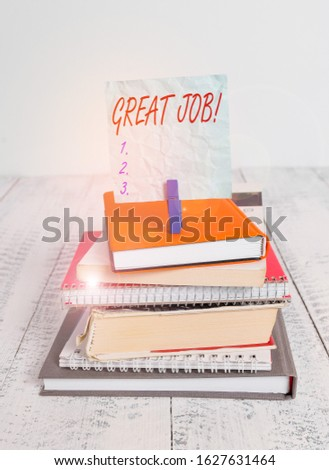 Conceptual hand writing showing Great Job. Business photo showcasing used praising someone for something they have done very well pile stacked books notebook pin color reminder white wooden.