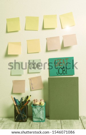 Conceptual hand writing showing Great Job. Business photo text used praising someone for something they have done very well Sticky Notes Card on Wall Pencil Pots Notebook on Work Desk. #1546071086