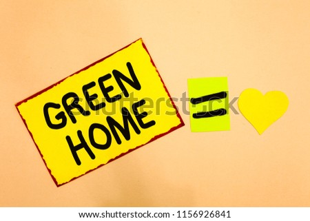 Conceptual hand writing showing Green Home. Business photo text An area filled with plants and trees where you can relax Yellow paper reminder equal sign heart sending romantic feelings. #1156926841