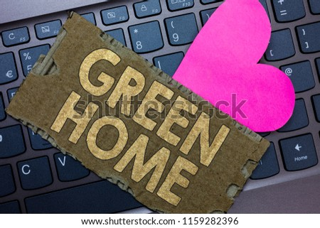 Conceptual hand writing showing Green Home. Business photo text An area filled with plants and trees where you can relax Paperboard Romantic lovely message Heart Keyboard Type computer. #1159282396