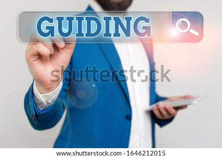 Conceptual hand writing showing Guiding. Business photo showcasing to show someone how to do something difficult Indicate the way.
