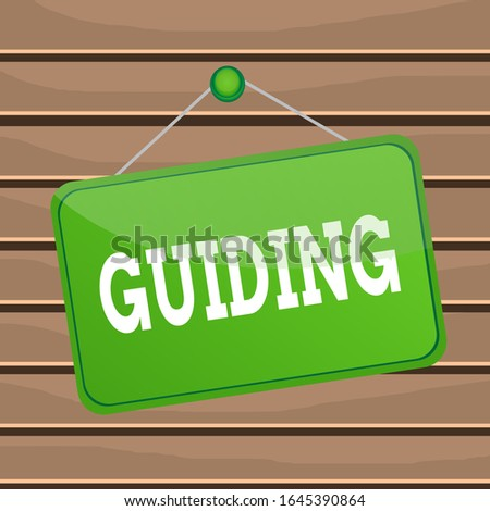 Conceptual hand writing showing Guiding. Business photo text to show someone how to do something difficult Indicate the way Memo reminder empty board attached background rectangle.