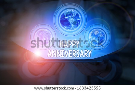 Conceptual hand writing showing Happy Anniversary. Business photo showcasing The annually recurring date of a past event celebration Elements of this image furnished by NASA.