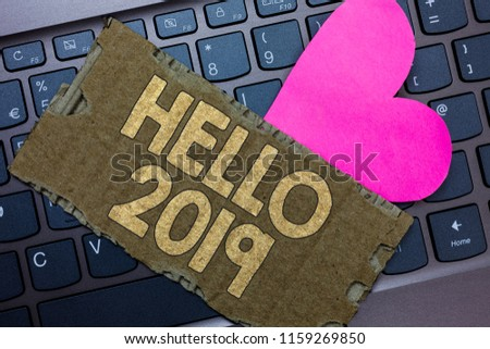 Conceptual hand writing showing Hello 2019. Business photo text Hoping for a greatness to happen for the coming new year Paperboard Romantic lovely message Heart Keyboard Type computer. #1159269850