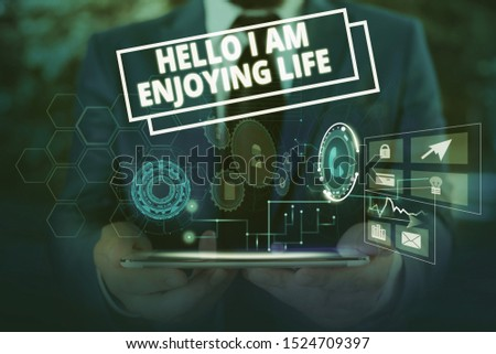 Conceptual hand writing showing Hello I Am Enjoying Life. Business photo showcasing Happy relaxed lifestyle Enjoy simple things Male wear formal suit presenting presentation smart device.