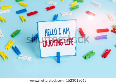 Conceptual hand writing showing Hello I Am Enjoying Life. Business photo text Happy relaxed lifestyle Enjoy simple things Colored clothespin papers empty reminder blue floor officepin. #1523015063