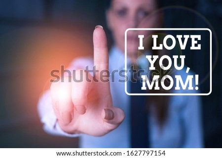 Conceptual hand writing showing I Love You, Mom. Business photo showcasing Loving message emotional feelings affection warm declaration Woman in the background pointing with finger in empty space.