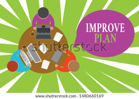 Conceptual hand writing showing Improve Productivity. Business photo showcasing to increase the machine and process efficiency Working table male employees electronic devices coffee cup.