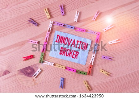 Conceptual hand writing showing Innovation Broker. Business photo text help to mobilise innovations and identify opportunities Colored crumpled papers wooden floor background clothespin.