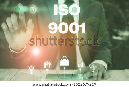 Conceptual hand writing showing Iso 9001. Business photo showcasing designed help organizations to ensure meet the needs of customers Male wear formal suit presenting presentation smart device. #1522679219