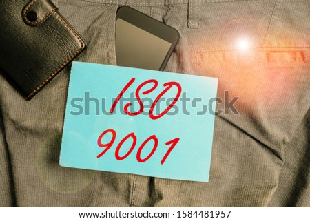 Conceptual hand writing showing Iso 9001. Business photo text designed help organizations to ensure meet the needs of customers Smartphone device inside trousers front pocket with wallet.