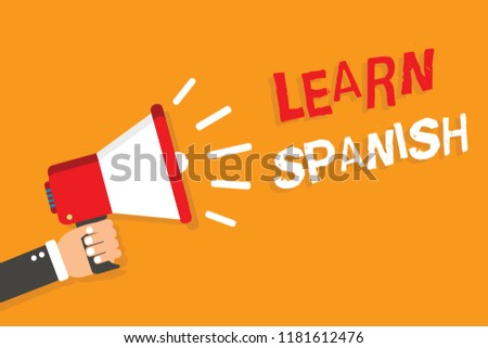 Conceptual hand writing showing Learn Spanish. Business photo showcasing Translation Language in Spain Vocabulary Dialect Speech Man holding megaphone orange background message speaking.