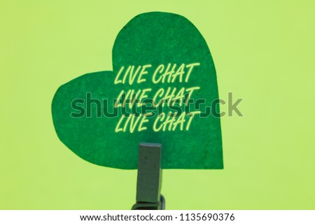 Conceptual hand writing showing Live Chat Live Chat Live Chat. Business photo showcasing talking with people friends relatives online Clothespin holding green paper heart romantic message ideas. #1135690376