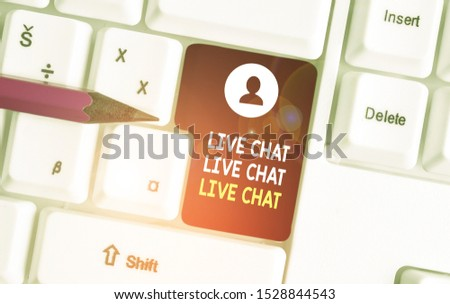 Conceptual hand writing showing Live Chat Live Chat Live Chat. Business photo showcasing talking with showing friends relatives online White pc keyboard with note paper above the white background.