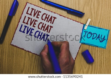 Conceptual hand writing showing Live Chat Live Chat Live Chat. Business photo text talking with people friends relatives online Man holding marker paper clothespin express ideas wooden table. #1135690241