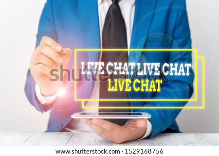 Conceptual hand writing showing Live Chat Live Chat Live Chat. Business photo text talking with showing friends relatives online Businessman pointing with pen in empty copy space.