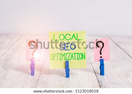 Conceptual hand writing showing Local Seo Optimization. Business photo text increase Search Visibility to Rank on Top list Crumbling sheet with paper clips placed on the wooden table.