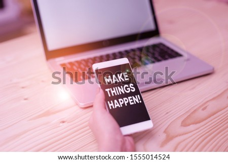 Conceptual hand writing showing Make Things Happen. Business photo showcasing you will have to make hard efforts in order to achieve it woman with laptop smartphone and office supplies technology.