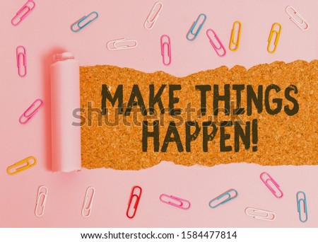 Conceptual hand writing showing Make Things Happen. Business photo showcasing you will have to make hard efforts in order to achieve it Paper clip and torn cardboard on wood classic table backdrop.