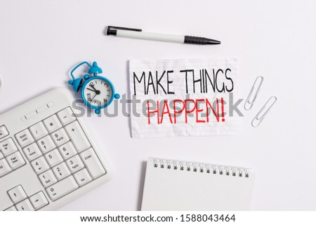 Conceptual hand writing showing Make Things Happen. Business photo showcasing you will have to make hard efforts in order to achieve it Copy space on note paper with clock and pencil on the table.