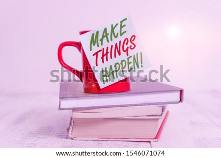 Conceptual hand writing showing Make Things Happen. Business photo text you will have to make hard efforts in order to achieve it Coffee cup sticky note stacked books retro old retro wooden table.