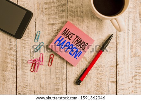 Conceptual hand writing showing Make Things Happen. Business photo text you will have to make hard efforts in order to achieve it Stationary placed next to a coffee cup above wooden table.