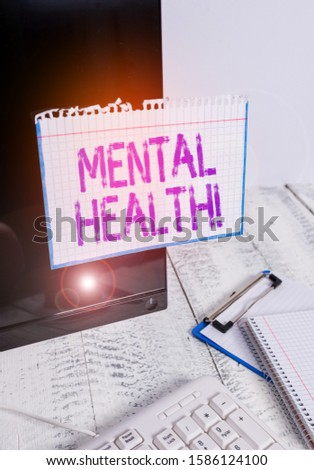 Conceptual hand writing showing Mental Health. Business photo text demonstratings condition regard to their psychological well being Note paper taped to black screen near keyboard stationary.
