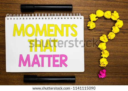 Conceptual hand writing showing Moments That Matter. Business photo showcasing Meaningful positive happy memorable important times White page with bright color word black pen yellow paper lob. #1141115090
