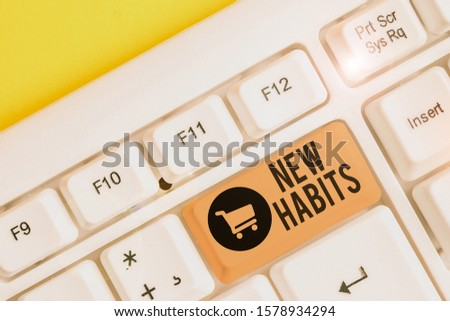 Conceptual hand writing showing New Habits. Business photo showcasing change the routine of behavior that is repeated regularly White pc keyboard with note paper above the white background.