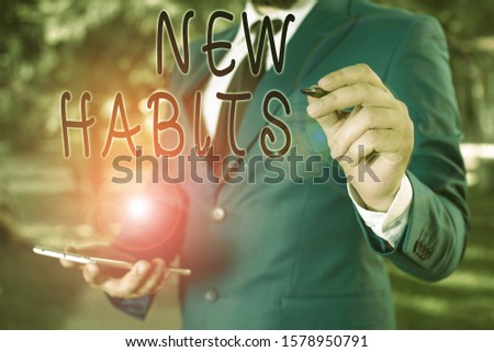 Conceptual hand writing showing New Habits. Business photo text change the routine of behavior that is repeated regularly Businessman holds laptop and pen pointing into the copy space.