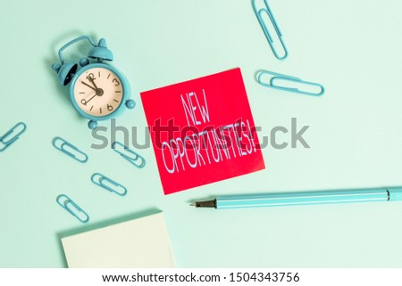 Conceptual hand writing showing New Opportunities. Business photo showcasing exchange views condition favorable for attainment goal Alarm clock notepad sticky note marker colored background.