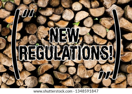 Conceptual hand writing showing New Regulations. Business photo text rules made government order control something done Wooden background vintage wood wild message ideas thoughts.