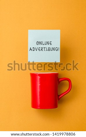 Conceptual hand writing showing Online Advertising. Business photo text Internet Web Marketing to Promote Products and Services Front view coffee cup colored sticky note yolk color background.