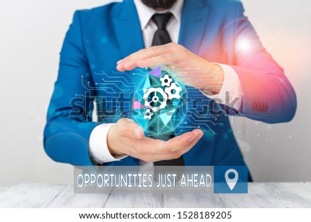 Conceptual hand writing showing Opportunities Just Ahead. Business photo text Advantageous circumstances Perseverance pays off Male human wear formal suit presenting using smart device.
