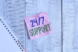 Conceptual hand writing showing 24 Or 7 Support. Business photo showcasing twentyfour hours seven days a week support to client Wrinkle note paper and notebook placed on wooden background.