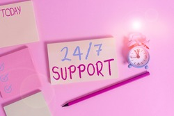 Conceptual hand writing showing 24 Or 7 Support. Business photo showcasing twentyfour hours seven days a week support to client Four multicolor notepads marker alarm clock color background.