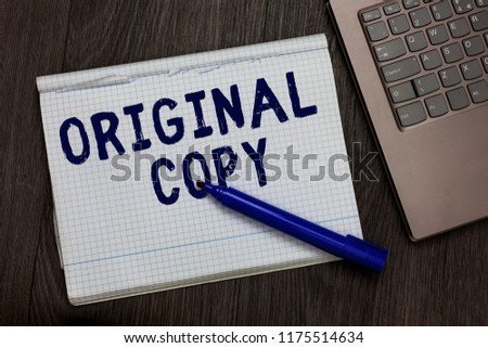 Conceptual hand writing showing Original Copy. Business photo text Main Script Unprinted Branded Patented Master List Open notebook squared page black marker computer wooden background. #1175514634