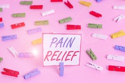 Conceptual hand writing showing Pain Relief. Business photo showcasing Drugs or other methods of reducing or getting rid of pain Colored clothespin papers empty reminder pink floor office.