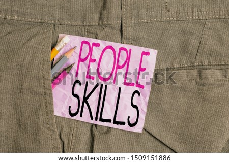 Conceptual hand writing showing People Skills. Business photo text Get Along well Effective Communication Rapport Approachable Writing equipment and purple note paper inside pocket of trousers.