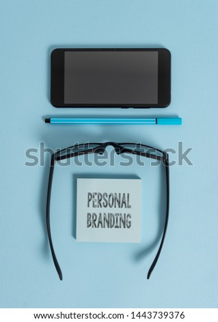 Conceptual hand writing showing Personal Branding. Business photo text Practice of People Marketing themselves Image as Brands Dark eyeglasses colored sticky note smartphone pastel background.