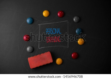 Conceptual hand writing showing Personal Branding. Business photo text Practice of People Marketing themselves Image as Brands Round Flat shape stones with same sizes stick black board.