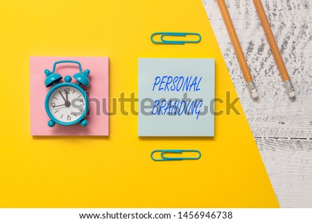 Conceptual hand writing showing Personal Branding. Business photo text Practice of People Marketing themselves Image as Brands Notepads colored paper sheet markers alarm clock wooden background.