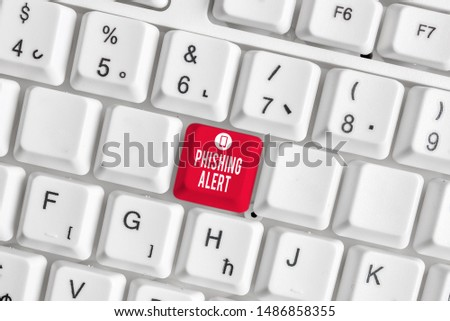 Conceptual hand writing showing Phishing Alert. Business photo text aware to fraudulent attempt to obtain sensitive information White pc keyboard with note paper above the white background.