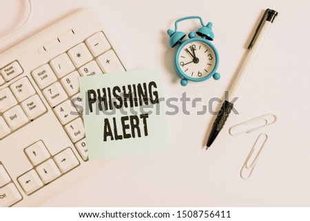 Conceptual hand writing showing Phishing Alert. Business photo text aware to fraudulent attempt to obtain sensitive information White pc keyboard with empty note paper above white background.