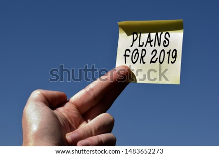 Conceptual hand writing showing Plans For 2019. Business photo text an intention or decision about what one is going to do Square paper piece notation stick to textured glass window. #1483652273