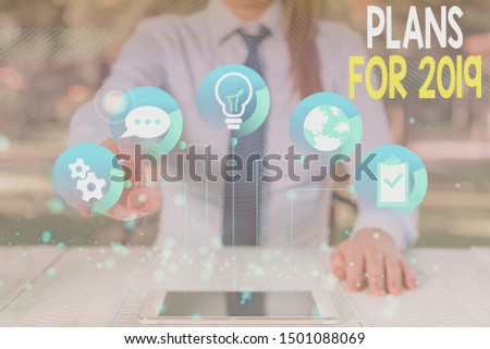 Conceptual hand writing showing Plans For 2019. Business photo text an intention or decision about what one is going to do Female human wear formal work suit presenting smart device. #1501088069