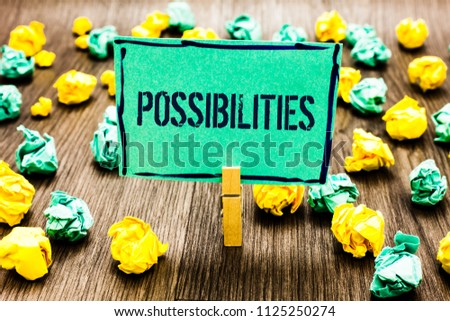 Conceptual hand writing showing Possibilities. Business photo showcasing Things that may happen or be the case State of being possible Crumpled papers ideas mistakes paperclip clip objects wood. #1125250274